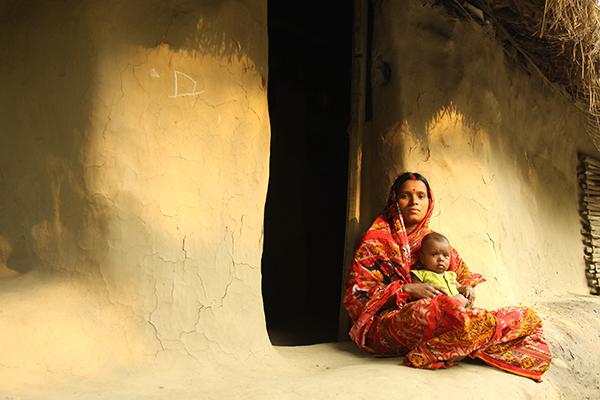 Bharati holding her baby girl